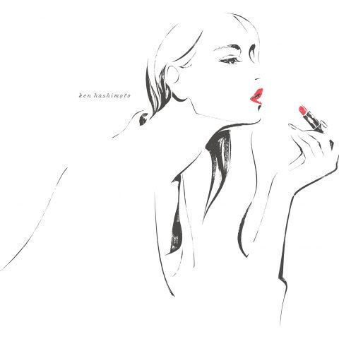 リップを塗る左利きの女性